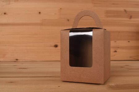 brown paper box with transparent window