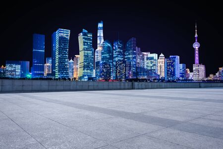 Panoramic empty floor with modern business office building at night