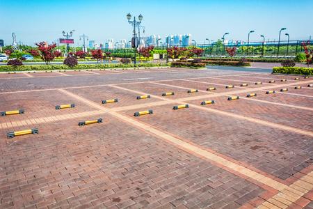 unoccupied: Empty Parking Lot ,Parking lane outdoor in public park Stock Photo