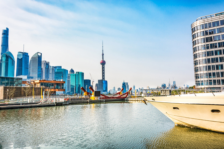 ruder: SHANGHAI, CHINA - MARCH 25: Pudong district view from The Bund waterfront area on March 25, 2016 in Shanghai, China. Pudong is a district of Shanghai, located east of the Huangpu River. Editorial