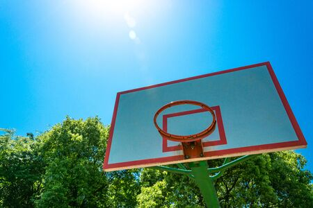 basketball hoop and backboard with blue sky