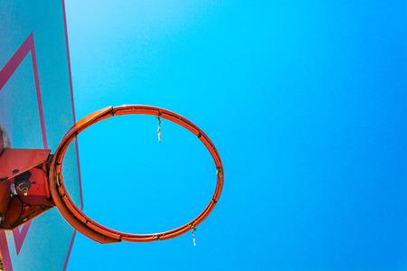 blacktop: basketball hoop and backboard with blue sky