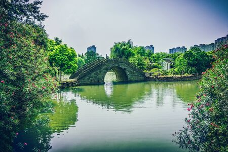 Old bridge in Chinese park Editorial