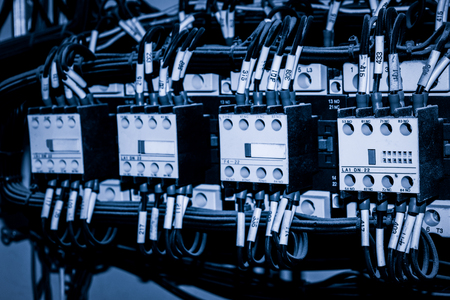 Close up of circuit switches and wire in control panel
