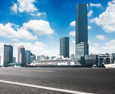 Business district cityscape from a park with blue sky Stock Photo
