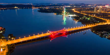 City scenery and traffic flow in Suzhou industrial park at night