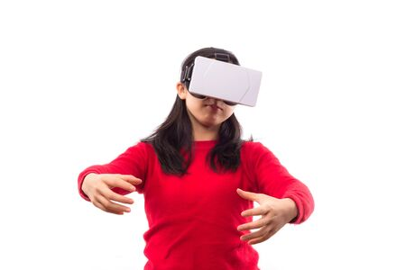Girl with virtual reality headset and joystick playing video games