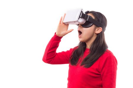 Surprised woman wearing virtual reality goggles isolated on white background