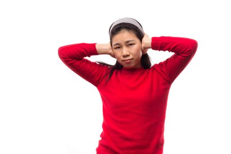 Don't want to hear it  Woman covering her ears. Isolated on white. Banco de Imagens