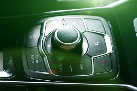car air conditioning system,finger hitting car emergency light botton,Hand tuning fm radio button in car panel.