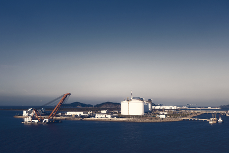 Liquefied natural gas storage tanks on the sea