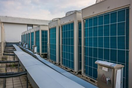 This photograph represents an industrial air conditioning unit cooling system on the roof of a building