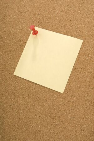 pin board: Red push pin holding a square note to a cork board. Stock Photo