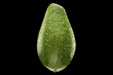 wet ripe green avocado isolated on black background Stock Photo - 16385564