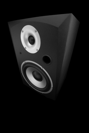 close up of a studio monitor speaker isolated on black background shot from a high angle photo