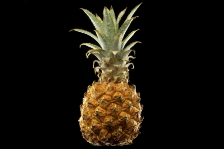 fresh wet pineapple isolated on black background Stock Photo - 16385597
