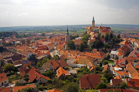 Aerial view on old, medieval european town with towers of baroque / renaissance castle and cathedral. Calm, peaceful, beautiful landmark of Moravia in southern Czech Republic