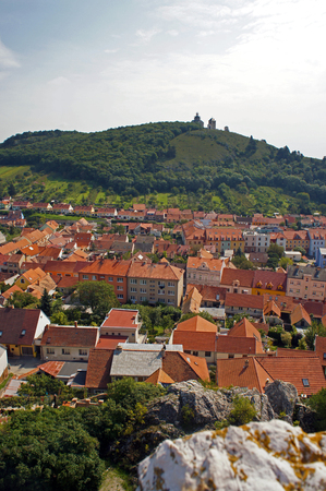 Aerial view on old, medieval central town with green hill with churches and chapels on it. Calm, peaceful, beautiful landmark of Moravia in southern Czech Republic