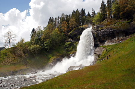 Steinsdalsfossen waterfall in the river of steine ??- scenic landscape with cascade surounded by mountains, Norway Stock Photo