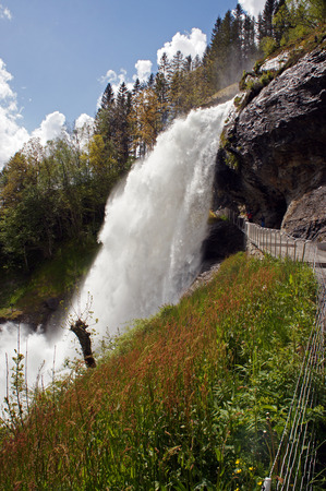 hardanger: Steinsdalsfossen waterfall in the river of Steine ??- scenic landscape with cascade surounded by mountains and rocks Stock Photo