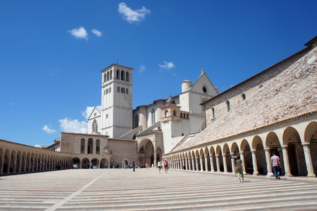 Basilica of San Francesco dAssisi in Italy - main patio and church entrance Stock Photo