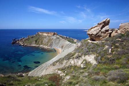 Rocky cliffs of Gnejna Bay, Golden Bay, Malta Stok Fotoğraf