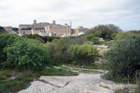 St. Luke's Hospital in Pieta, Malta, as visible from fortifications of Floriana Archivio Fotografico