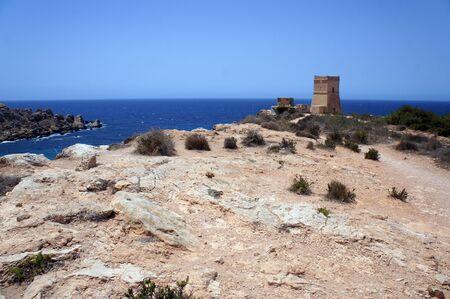 Panorama with Ghajn Tuffieha (Għajn Tuffieħa) Tower on the cliff next to the harbor,Golden Bay, Malta