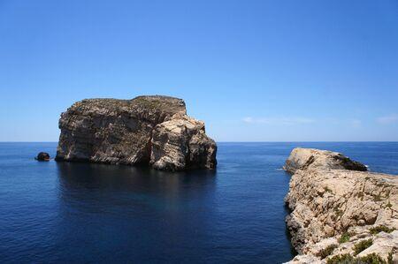 Fungus Rock and landscape of Dwejra Bay next to Azure Window (it-Tieqa Å»erqa) in Xlendi, Gozo