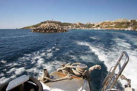 Landscape of Mgarr Harbor in Gozo, Malta visible from yacht deck