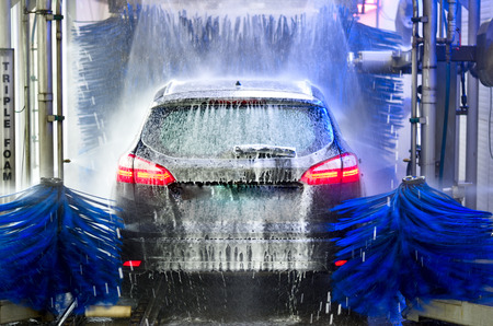A car in an automatic car wash
