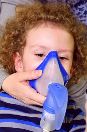 Sick child uses inhaler