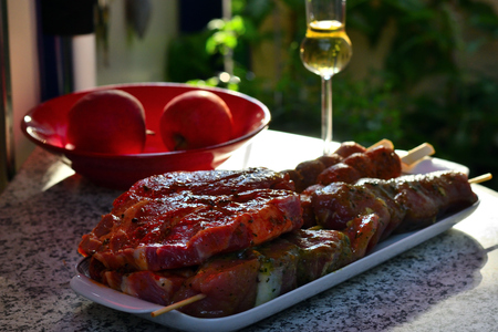 Grilled meat in shell on a table with apples and glass Stok Fotoğraf