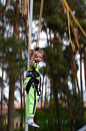 Child on Bungee Trampoline Stockfoto