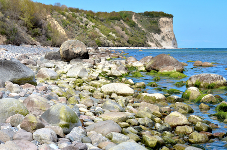 Stones, algae and water at Cape Arkona on the island of Rügen