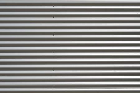 Wall made of grey corrugated sheet metal