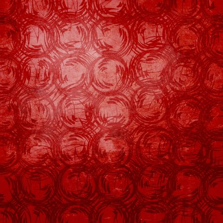 Rough circular repeating pattern in deep reds, softly distressed.  Abstract background with paper grain texture. photo