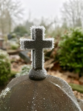 tombstones: Frozen cross Stock Photo