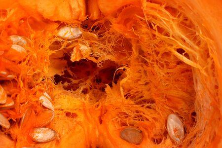 Pumpkin in half. close-up. Half Pumpkin Seed, Raw Food. Vegetarian food. Abstract texture