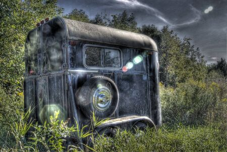 over grown: Abandonded horse trailer  Stock Photo