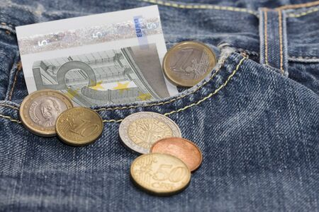 European currency in pocket of blue jeans
