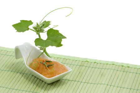 Squash soup in white spoon   Stock Photo