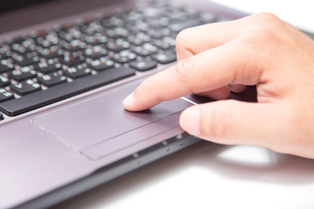 trackpad: Male hands typing on a laptop trackpad