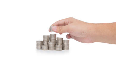 tabulate: Hand put coins to stack of coins isolated on white background