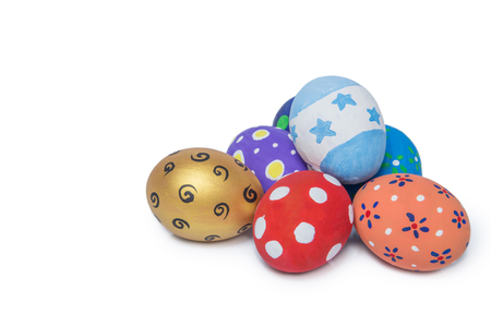 white eggs: Pile of colorful handmade easter eggs isolated on white Background