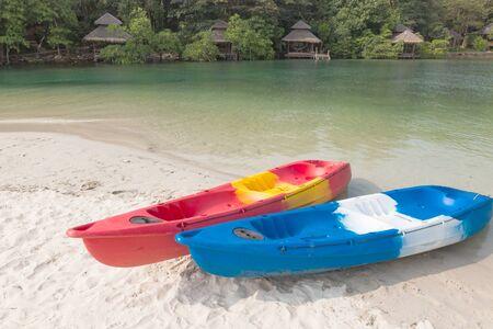 kood: kayaks on sandy beach, koh kood island, Thailand Stock Photo