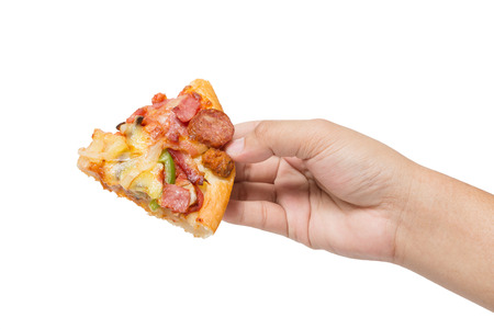 flavorful: hand holding tasty flavorful pizza isolated on white background Stock Photo