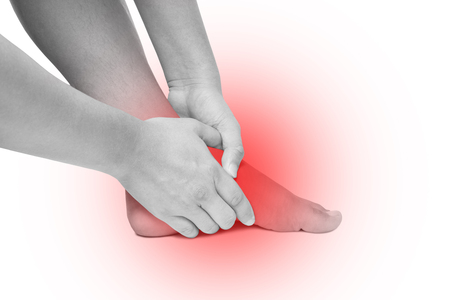 Acute pain in foot sole, hand massage foot sole isolated white background