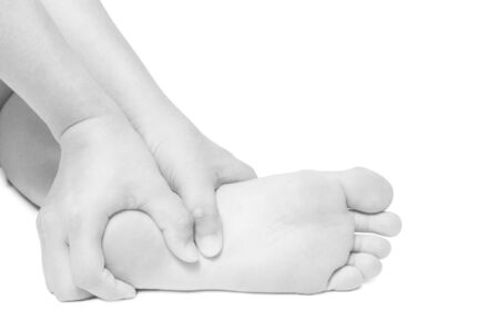 acute: Acute pain in foot. hand massage foot isolated white background