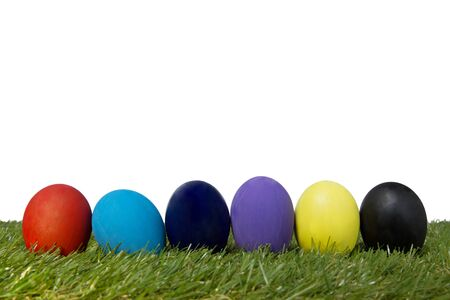 Colorful handmade easter eggs on green grass isolated on a white Background Stock Photo
